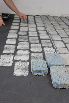 cobblestones-French Linen and Paris Grey-start by laying out the cobbles sponges after rolling them with paint-Colin follows along and adds smears and swipes of French linen and Graphite and then sponges it in.