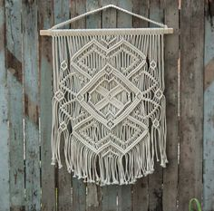 This gorgeous modern macrame wall hanging was inspired by the ancient pattern of traditional Ukrainian embroidery. Centuries ago this geometric design of the macrame wall art was a popular symbol that one could find on the old-times embroidered blouses. I call this macrame hanging The Ethnic Pattern, as it is borrowed from the Ukrainian culture. It is one of my favorite. I imagine this macrame decor on the wall right on the top of your bed, bringing a boho touch to your bedroom. But its…