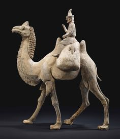 A FINE PAINTED POTTERY BACTRIAN CAMEL WITH SOGDIAN RIDER -  CHINA, TANG DYNASTY, CIRCA 7TH CENTURY.
