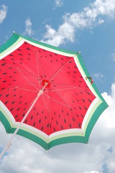watermelon umbrella - inspiration for a tablecloth - green, white, and then red on top - dot with black for a theme party