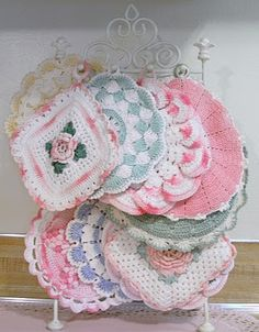 Shabby, Pink and Pretty...displayed pot holder collection on jewelry holder...clever!