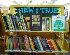 """New & True"" library book bulletin board display"