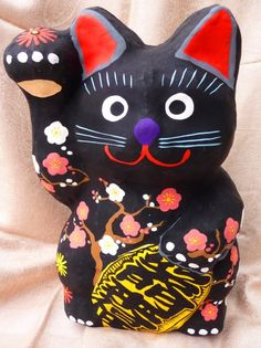 Hand-painted paper-mache Maneki Neko purchased at a shop in Nagoya