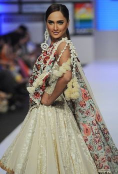 A model presents a creation by Pakistani designer on the third day of the Fashion Pakistan Week in Karachi on April 9, 2012.