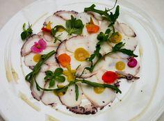Octopus carpaccio with orange and tamatind sauce at Signature Restaurant in Warsaw
