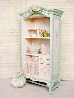 Two shabby cottage chic cupboards like the pictured piece in half scale. will be minor differences as it is one-of-a-kind. Two Custom Companion display cupboards to coordinate with first cupboard purchased....details discussed via email / messaging including wall shelf addition. Free shipping - combined.  French Cottage chic for any room. Hand-painted and aged Hand-sculpted roses, Pinks, mints and blues - antiqued Antique pink lace  Ships worldwide Please allow up to 10 weeks for complet...