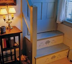 A simple anthemion pattern from Liberty Design Co. subtly decorates the risers of a closed stair.