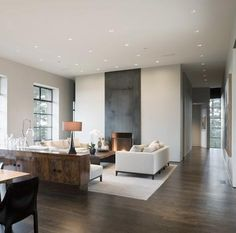 Modern Living Room | Steel fireplace accented with straight clean lines & white furniture. Contemporary & modern decor. DIY interior design ideas.