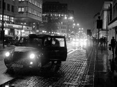 Taken on the Strand, London on a rainy night. I love rain and capturing it creatively. I will often go out in the rain with my camera and take photos. I saw this black cab and some people getting it and liked the silhouette effect as they got in caused by the backdrop of lighting. I also liked how the taxi cab head lights lit up the rain and the reflective paving stones giving this image a lot of textures.  DESCRIPTION: Kodak Metallic print finish on quality, archival professional paper.