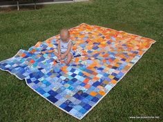 I am in love with this quilt, perhaps because of my unlady-like obsession with blue and orange :)