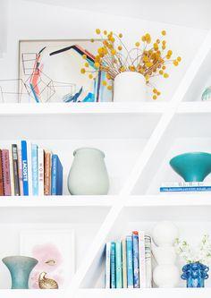 Emily Henderson Bookcase midcentury modern clean white accessories