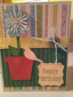 Used cricut songbird cartridge, 3d flower, ribbon and button.