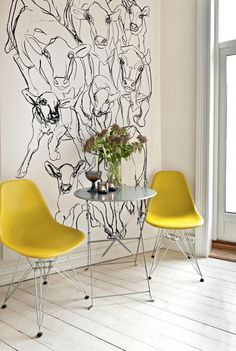 "On the wall: ""Kevatjuhla"" (Vårfest) fabric from Marimekko. Love Marimekko. And the chairs."