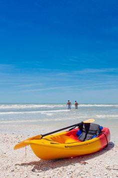 MustDo.com | Sea kayak on the beach at Clam Pass Beach Park in Naples, Florida. Photo by Debi Pittman Wilkey.