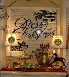 Merry Christmas vinyl on an old window with sheet music behind  @Ashleigh Queen...doesn't the 'sheet music' look just like the wrapping paper I bought today!!!  We can do this!  The black with the cricut!