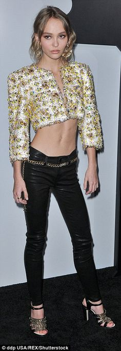 Winning them over: Lily-Rose wore the extreme crop top with leather trousers to the glamor...