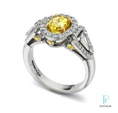 Yves Frey oval shape yellow diamond with two kite shaped side stone diamonds flanked by small brilliant cut diamonds and six small yellow diamonds.