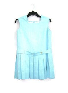 1960s kids light blue slubby rayon shift dress. Jumper uniform style. Sleeveless, boxy cut, drop waist and pleated mini skirt. Fully lined