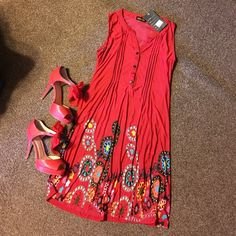 NWT Reborn dress Sleeveless dress. Brand new. Tags on. Silky feel. Beautiful design. Impulse buy.  Reborn Dresses Mini
