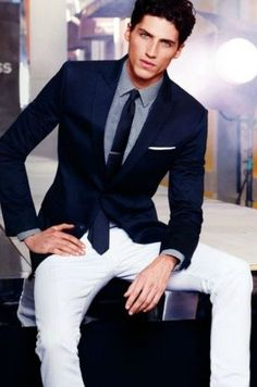 blue suit jacket with white pants