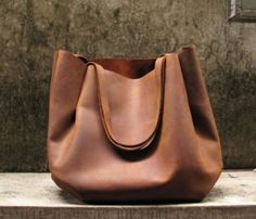 Strapped Shoulder Bag: I may have to make this out of my old red leather skirt