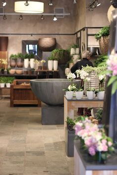 modern, earthy flower shop  Looove the style...Andrée...