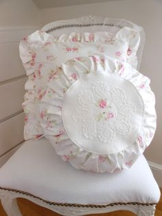 Furnishings:  White Shabby Chic chair with pillows.