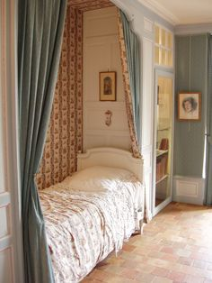 This bedroom would be any little girls dream. With it's soft pastel color palette, bed nook, pretty floral wallpaper and matching curtains. The brick floor is equally wonderful. This intimate little room belongs to the unique Chateau Villandry.
