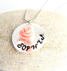 Check out this item in my Etsy shop https://www.etsy.com/listing/256920018/flower-girl-name-necklace-with-flower