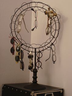 Old postcard display rack turned eyeglasses holder