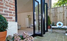 With this handy guide, we bring you everything to know about summer bi-fold doors, as well as how to customise them for your home this warm season. Garden Table, Garden Planters, Garden Art, Garden Design, Bed Springs, Folding Doors, Home Repair, Diy Table, Diy For Kids