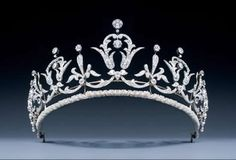 A magnificent Belle Epoque platinum and diamond tiara/necklace of graduated scroll and foliate design, set  throughout with old brilliant cut, single cut, and rose cut diamonds. The tiara frame detaches w/a small screwdriver, transforming the tiara into a necklace.
