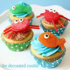 crab and fish cupcake toppers by thedecoratedcookie, via Flickr