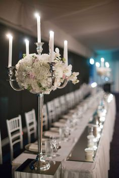 sit some muted toned flowers within the subtle arc of a candelabra. #StemDesign