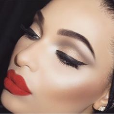 Flawless skin, red lipstick and neutral shadow with black eyeliner!!:)