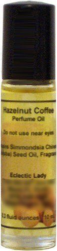 Hazelnut Coffee Perfume Oil, Small by Eclectic Lady. $7.99. Dye Free. 0.3 Fluid Ounces. Preservative Free. Roller Ball Bottle. Alcohol Free. Roll on our perfume oil with our travel friendly glass bottles. This perfume oil bottle is small enough to meet airline regulations and fit into your purse along with being eco-friendly glass and recyclable plastic. Our Hazelnut Coffee fragrance smells like fresh brewed coffee with hazelnuts.We use jojoba oil as the base oil for o...