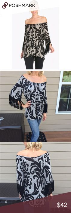 """Black and gray brocade knit top Perfect for the Fall!! Black and gray brocade pattern knit top. Faux suede fringe sleeve. Soft knit, very comfortable. Can be worn on or off the shoulder. I'm wearing the small, and I'm 5'9"""" 34D, size 2-4. Made in USA. Tops Tunics"""