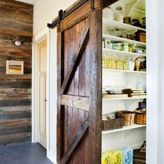 Meadow House - contemporary - kitchen - denver - Lawrence and Gomez Architects *love the mix of wood and tile, plus the barn door and paneled wall.