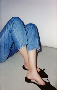 5d7c729fa06b84 Classic jeans and Manolo Blahnik mule flats. Taschen
