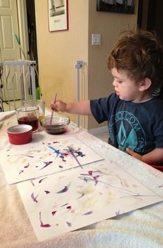 Painting with homemade watercolors made from fruits, veggies and tea. Play with your food project
