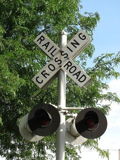 Railroad Crossing Sign by Laurel714, via Flickr