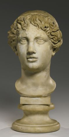 A Fragmentary Marble Head of a Youth, Circa 2nd Century A.D., Restored in the 18th Century