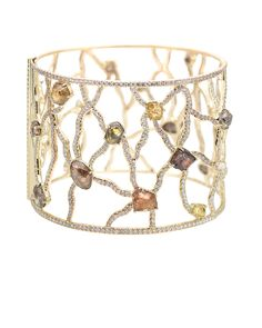 Sodwana Cuff featuring 22 rough diamonds totaling 32.72ct accented with 9.55cts of micro pavé diamonds in 18k yellow gold.