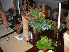 individual terra cotta pots painted bronze. each one was different, then we combined them all in the centerpieces.