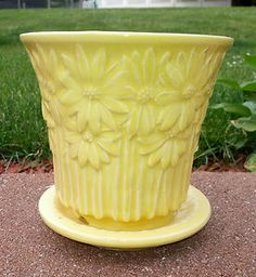 Vintage McCoy Yellow Daisy Planter- I have a reproduction in aqua. love it, looks like the real thing