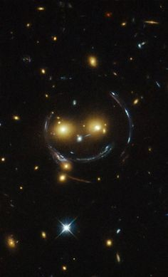 Hubble scientists recently discovered this galaxy cluster that resembles a face with two bright eyes, a button nose and a smile.