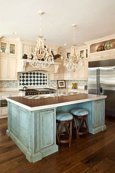 style of island and cabinets and seating. Wonder what top is? butcher block?    Also love cabinet style- no raised panels to clean.