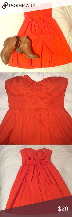 Strapless orange sundress This lightweight sundress cinched at the waist with a bow that ties on the back. Perfect for cheering on UT, Auburn or Florida or to wear as a guest to an early fall wedding! City Triangles Dresses Strapless