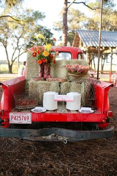 bold red and white details... apple red chairs .. gorgeous gerbera daisy centerpieces... adorable cowboy boots-turned vases on the fantastic vintage red truck... oyster roast dinner ... truly embraced the natural, woodsy feel of the surrounding landscape.  Be Prepared to Be Inspired…  http://merrybrides.tumblr.com/post/42572227066/rustic-rehearsal-dinner