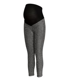 Black/silver-colored. Leggings in jersey with glittery threads. Wide ribbing at waist for added comfort.